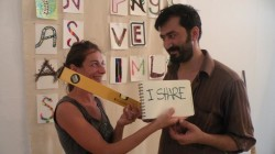 Ladre Erdal Rezes and Emanuela sharing a spirit level (hope this is the right word for it) during the set up of Canakkale Biennial